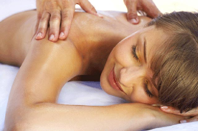 image of woman relaxing while having a massage